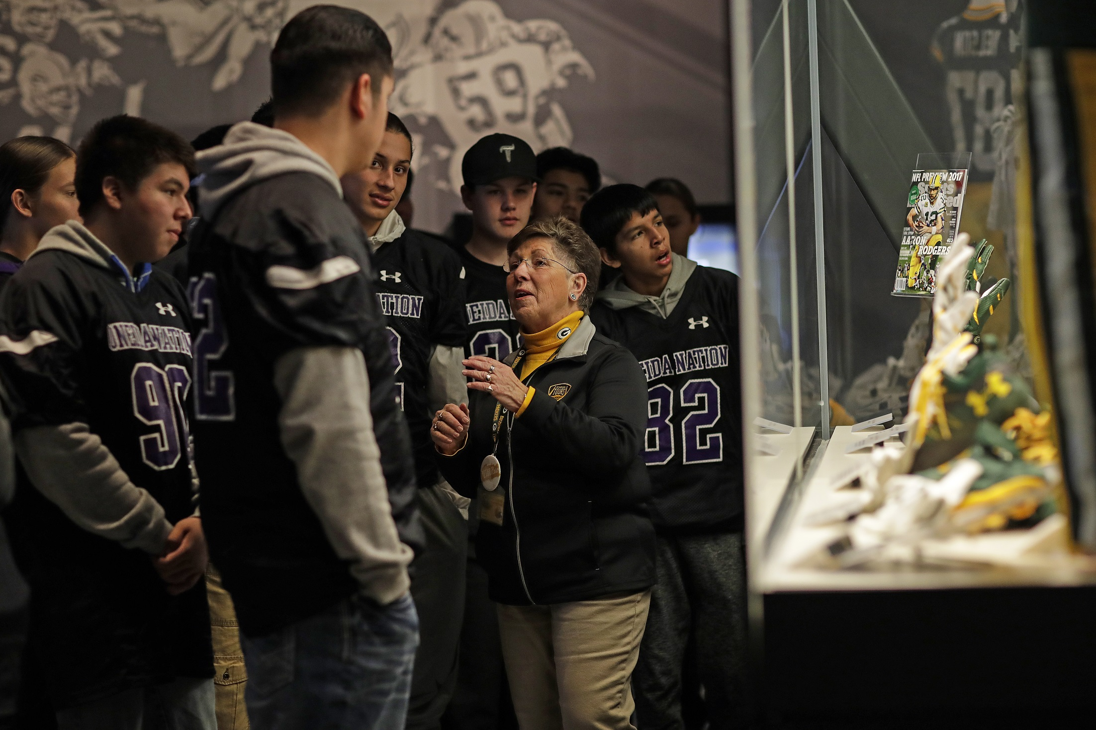 Youth listening to a tour guide in the Green Bay Packers Hall of Fame.